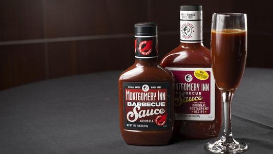 """Bottles of the new sauces are posed at the Montgomery Inn in Montgomery, Ohio, on Wednesday, March 23, 2016. After a two-year process the restaurant introduced gluten-free and """"no high-fructose corn syrup"""" sauces."""
