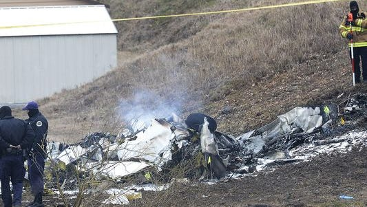 Investigators examine the site of a plane crash Feb. 4, 2014, near Nashville. The small plane crashed near a YMCA in Bellevue, Tenn., killing four members of a Kansas cattle rancher family.