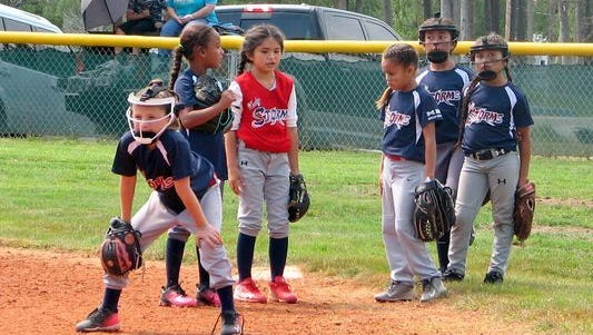 Girls compete in a previous fast-pitch competition staged in Ruidoso.