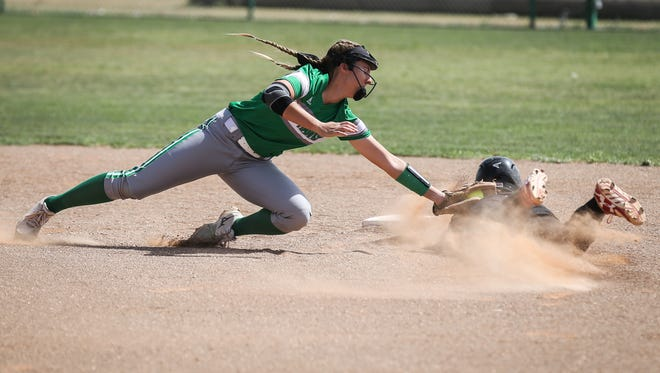 Wall's Ashley Dusek tries to tag out Ballinger's Lauren Jalomo at second base Friday, April 13, 2018, at Wall.