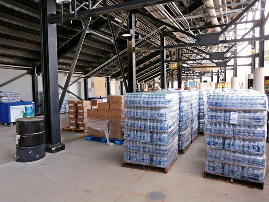 Pallets of bottled water along with other vending foods