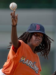Jamikus Stewart delivers a pitch during a scrimmage