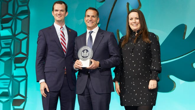Kohler Co. President & CEO David Kohler (center) is shown accepting the award from John Lanier, executive director of the Ray C. Anderson Foundation and grandson of the late Ray C. Anderson; and Rhiannon Jacobsen, vice president of strategic relationships, U.S. Green Building Council.
