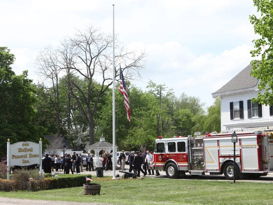 City of Poughkeepsie Fire Engine 2 parked in front of McHoul Funeral Home during the wake of fallen Fireman Timothy Gunther in Hopewell Junction on Saturday.