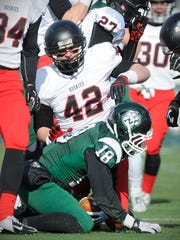 St. Cloud State linebacker Adam Josephson (42) gets up from a tackle during the Huskies' Division II national quarterfinal playoff game at Northwest Missouri State last December in Maryville, Mo.