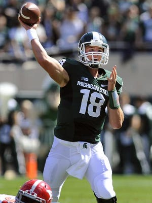MSU quarterback Connor Cook passes for a completion against  Youngstown State Saturday 9/14/2013 .  (Lansing State Journal | Rod Sanford)