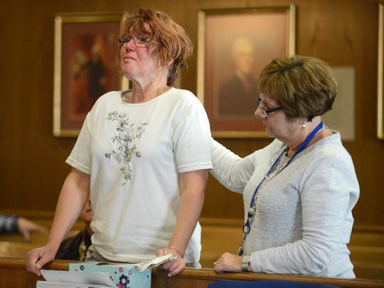 Franki Nutter, left, takes a breath as she fights back tears while telling the Judge Richard Berens about how the death of her mother Mary Nutter affected her and her family Thursday during the sentencing hearing for Christopher B Bayer II. Bayer was sentenced to four years in prison for hitting and killing Mary Nutter with a vehicle. Maria Schmelzer, a victim assistance specialist with the Fairfield County Prosecutor's Office is pictured with Franki Nutter.