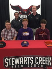 Stewarts Creek soccer standouts (front row, l-r) Peyton Markos, Carter Smith and Tristan Skelton all signed to play college soccer recently. Pictured in the back row (l-r) are Stewarts Creek coach Brooke Mayo and SCHS principal Clark Harrell.
