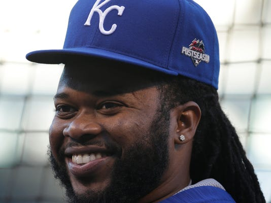 This photo taken Oct. 16, 2015, shows Kansas City Royals starting pitcher Johnny Cueto, right, talking to a Toronto Blue Jays players before Game 1 of baseball's American League Championship Series on  in Kansas City, Mo. The San Francisco Giants' upgraded rotation sure is taking shape, with the 2014 World Series champions agreeing to terms with Cueto on a six-year contract Monday, Dec. 14, 2015.  (AP Photo/Charlie Riedel,File)