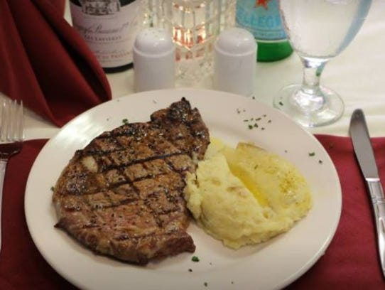 A ribeye steak with garlic mashed potatoes from Trotta's
