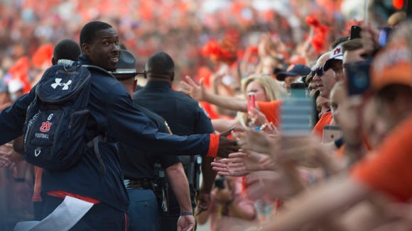 Auburn quarterback Jeremy Johnson (6) walks in Tiger Walk before the Auburn vs. Clemson NCAA Football game at Jordan-Hare Stadium on the campus of Auburn University in Auburn, Ala. They are all a member of the newly official Super Fan at Auburn.
