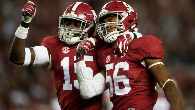Alabama linebacker Tim Williams (56), here with Ronnie Harrison, will be a problem for Washington if it doesn't pay him extra attention in Saturday's College Football Playoff semifinal game.