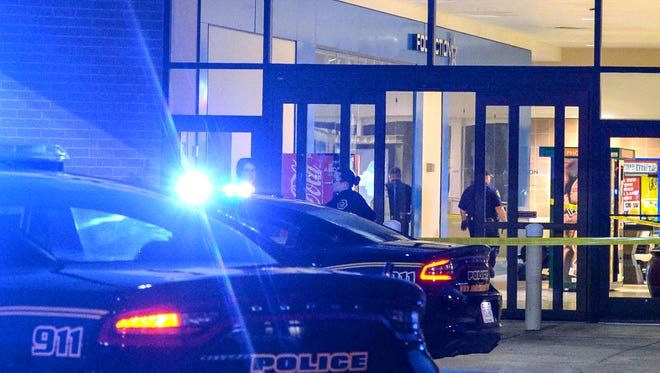 Anderson police and investigators work at the scene at the food court entrance of the Anderson Mall, near where a man was shot near the Foot Action store in Anderson on Friday.