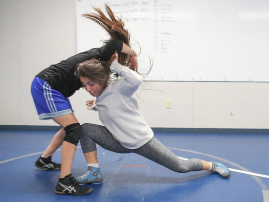Britney Garnica, right, practices with a teammate during