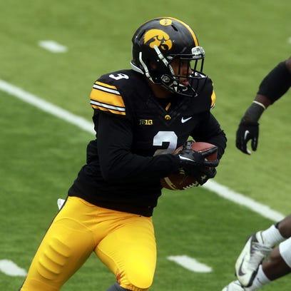 Iowa wide receiver Jay Scheel runs down field during