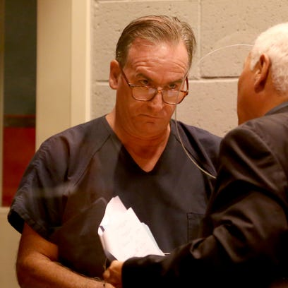 John Rideout speaks with an attorney as he is arraigned