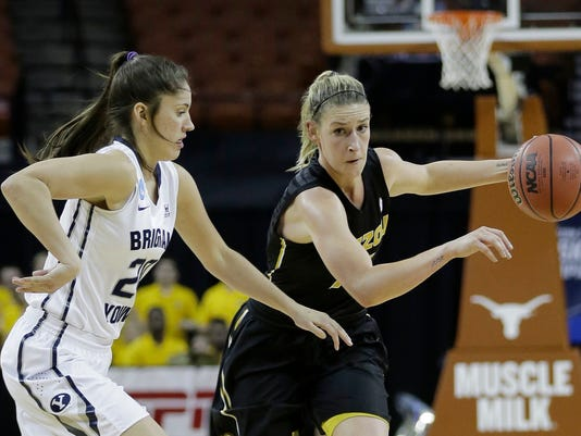 Missouri guard Lindsey Cunningham (11) drives the ball up court past Brigham Young guard Cassie Broadhead (20) during a first-round women's college basketball game in the NCAA Tournament, Saturday, March 19, 2016, in Austin, Texas. (AP Photo/Eric Gay)