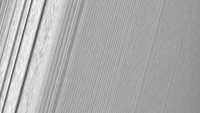 """This Cassini image features a density wave in Saturn's A ring (at left) that lies around 134,500 km from Saturn. Density waves are accumulations of particles at certain distances from the planet. This feature is filled with clumpy perturbations, which researchers informally refer to as """"straw."""""""