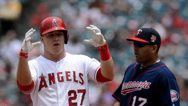 Los Angeles Angels center fielder Mike Trout (27) reacts after hitting a double in front of Minnesota Twins first baseman Kendrys Morales (17) during the third inning at Angel Stadium of Anaheim.
