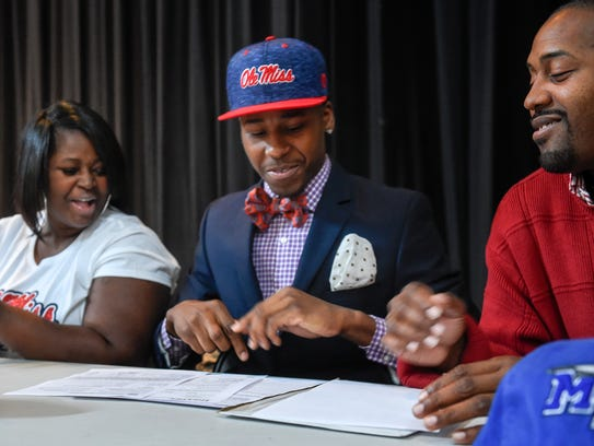 JaVonta Payton signs with Ole Miss with his mother