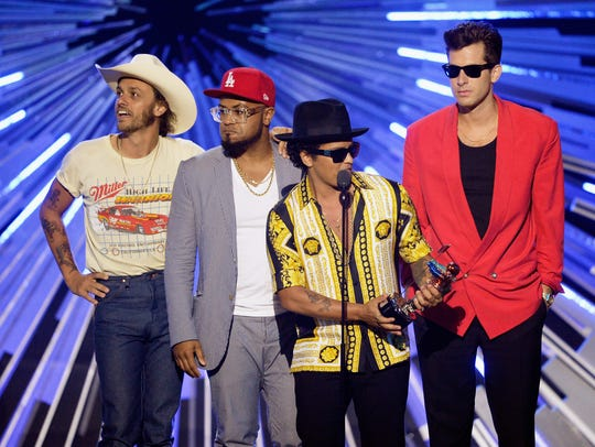 Bruno Mars (C) and Mark Ronson (R) accept the Best
