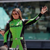 Danica Patrick waves as she's introduced before the start of the Indianapolis 500 auto race at Indianapolis Motor Speedway, in Indianapolis Sunday, May 27, 2018. (AP Photo/Michael Conroy) ORG XMIT: NAA112