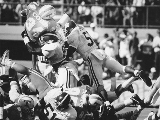 Reggie Cobb leaps over the line during a successful fourth down attempt on October 15, 1988 during the Tennessee-Alabama game.