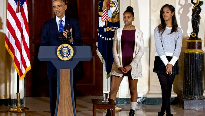 President Obama, joined by his daughters Malia, right, and Sasha, center, during the presidential turkey pardon ceremony.