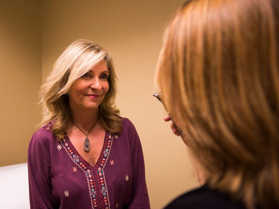 Dr. Erin E. Chambers checks patient Suzanne Hopkin's