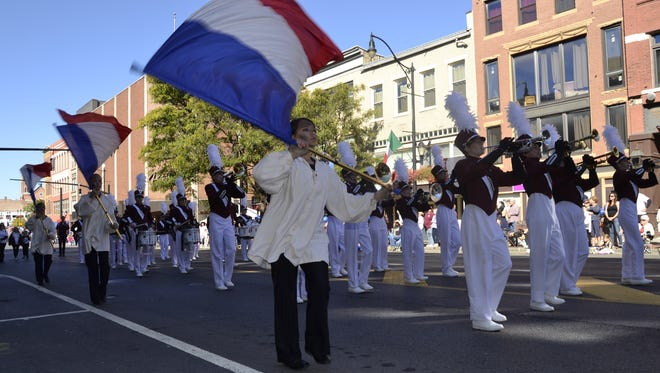 Johnson City's marching band performs during Monday's parade in downtown Binghamton.