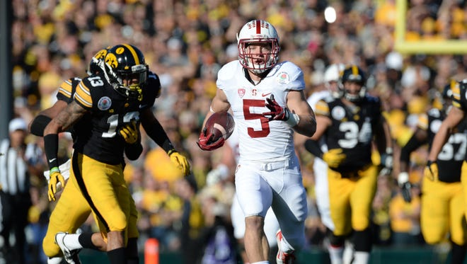 Stanford Cardinal running back Christian McCaffrey streaks past Iowa defenders for a TD.