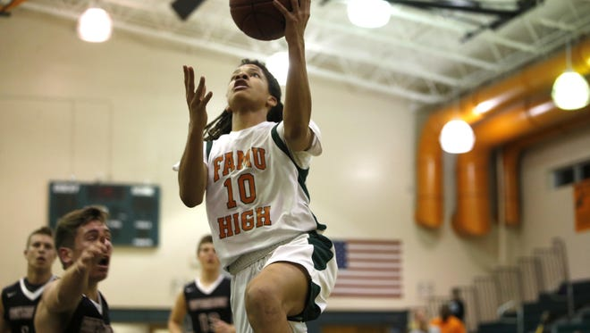 FAMU DRS' Mekhi Yant goes up for a layup in a first-round playoff game. The Rattlers play in a 2A state semifinal on Tuesday afternoon.