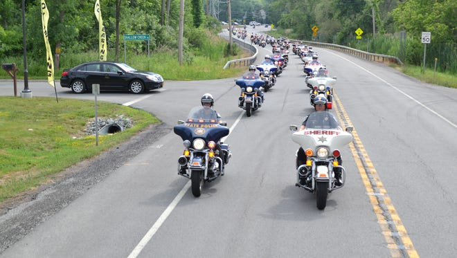 A caravan of law enforcement officers escorted Gov. Andrew Cuomo out of Rochester after his stop in Victor Friday afternoon.