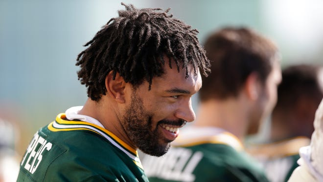 Green Bay Packers outside linebacker Julius Peppers (56) smiles during Green Bay Packers during Training Camp at Ray Nitschke Field.