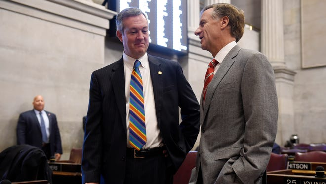 Gov. Bill Haslam talks to Secretary of State Tre Hargett before Tennessee's electors cast their votes in the Electoral College on Monday Dec. 19, 2016, in Nashville, Tenn.