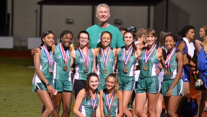 The Lafayette High Lady Lions pose with coach Ron Baillargeon after winning the District 3-5A title.