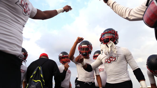 West Oso Bears get revved up prior to their game against the London Pirates on Friday, September 29, 2017 at Pirate Stadium.