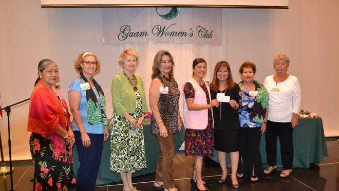 Guam Women's Club presented a check in the amount of $1000 Guam Memorial Hospital Volunteers Association at their recent business meeting held at the Sheraton Laguna Guam Resort on May 25, 2018. Pictured from left: Dorothy Borlas, GMHVA past president; Renee Veksler, GWC member; Donna Kloppenburg, GWC lifetime member; Al Payne, GMHVA; Joyce Crisostomo, GMHVA president; Leo Jordanou, GWC president; Rena Borja, GWC lifetime member; Sue Biolchino, GWC member.