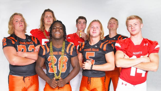 Front: Washington's Carson Wilson, from left, Tupak Kpeayeh, Nate Freese, and Lincoln's Avry Rice. Back: Lincoln's Grant Treiber, from left, Zach Hanson and Washington's Jayden Johannsen during football media day Tuesday, Aug 7, at Argus Leader Media in Sioux Falls.