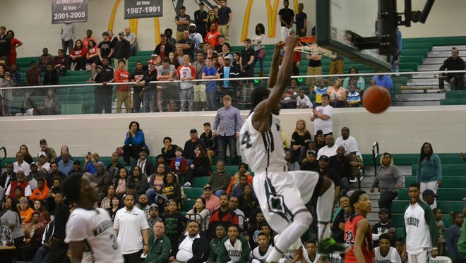 Peabody's Kevin Norman slams home the final points as the Warhorses defeated Tioga 55-44 at Peabody Tuesday night in playoff action.