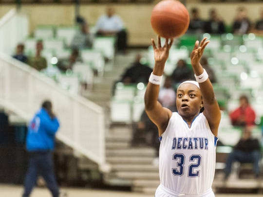 Stephen Decatur guard Dayona Godwin (32) takes a free throw against Queen Anne's in the 2015 Bayside Championship at the Wicomico County Youth and Civic Center.