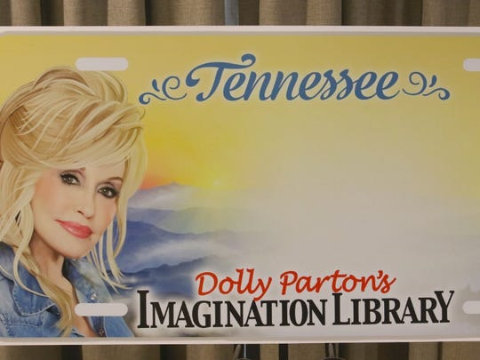The license plate has the Imagination Library logo, Parton's likeness and a silhouette of the Great Smoky Mountains.