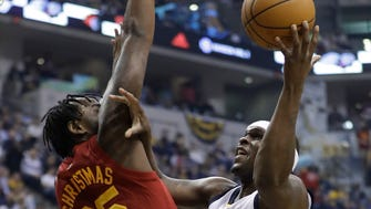 Memphis Grizzlies' Zach Randolph shoots against Indiana Pacers' Rakeem Christmas during the first half of an NBA basketball game Friday, Feb. 24, 2017, in Indianapolis. (AP Photo/Darron Cummings)