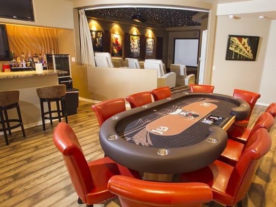 the basement poker table bar and theater area in the