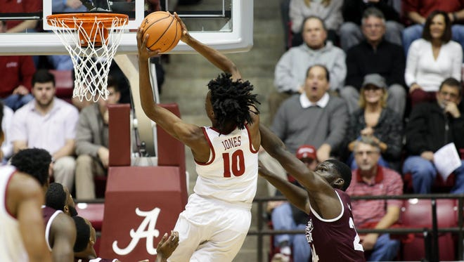 Jan 20, 2018; Tuscaloosa, AL, USA; Alabama Crimson Tide guard Herbert Jones (10) goes to the basket against Mississippi State Bulldogs forward Abdul Ado (24) during the first half at Coleman Coliseum. Mandatory Credit: Marvin Gentry-USA TODAY Sports