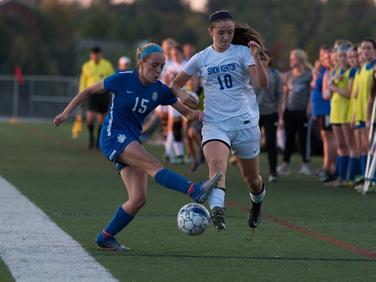 Sophomore forward Jade Waters, right, attacks down the side Oct. 20