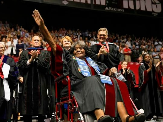 Autherine Lucy Foster acknowledges the crowd Friday as she receives an honorary doctorate during commencement exercises at the University of Alabama in Tuscaloosa, Ala. Foster was the first African American to attend the school.