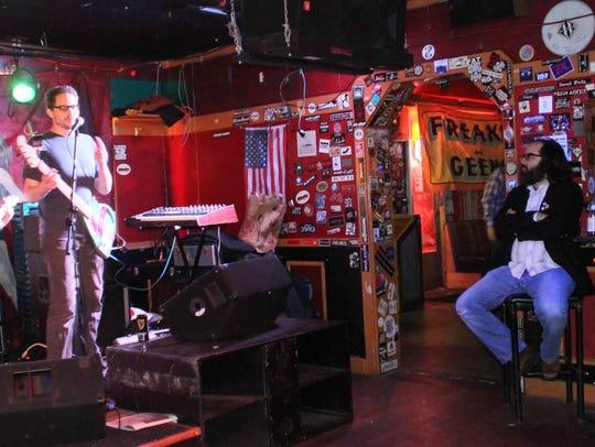 Casey Grabowski sings a song at the former Mojo 13