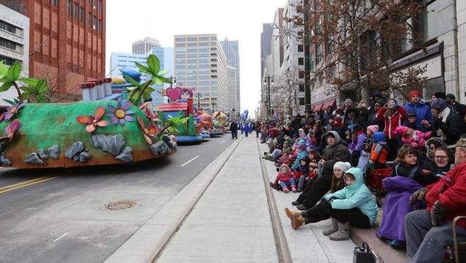 Woodward is lined with people to watch the 88th annual America's Thanksgiving Parade.