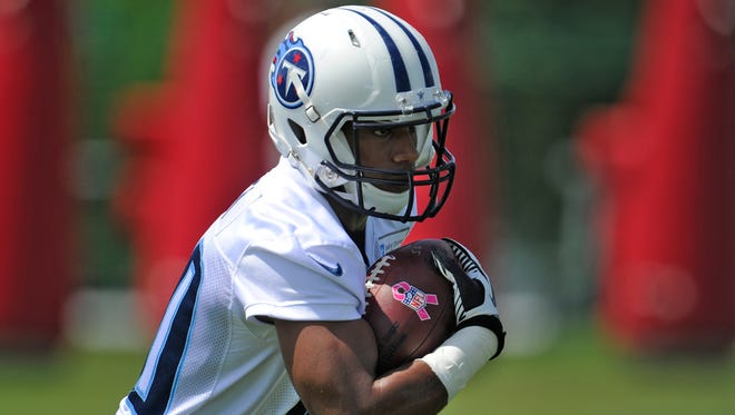 Titans running back Bishop Sankey (20) speeds up the field during practice Tuesday at St. Thomas Sports Park.